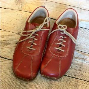 Footprints red sneakers